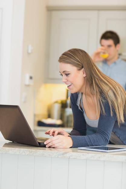Happy girl in headset speaking by webcam looking