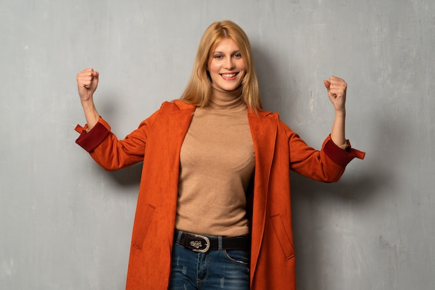 Woman over textured background proud and self-satisfied in love yourself concept Premium Photo