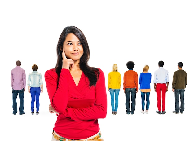 Woman thinking with diverse people behind her Free Photo