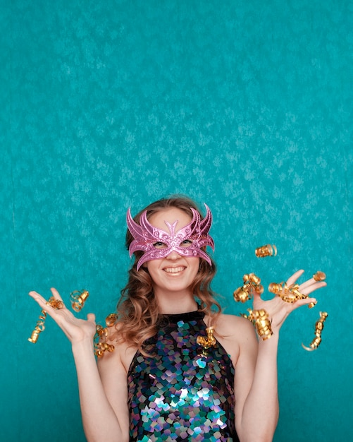 Woman throwing with glitter and ribbons medium shot Free Photo