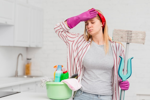 Woman tired from cleaning at home Free Photo