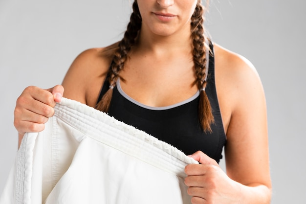 Woman in top tank getting dressed in uniform Free Photo