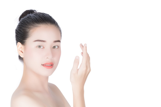 Woman touching her face, cosmetology, beauty and spa, while isolated on white background. Premium Photo