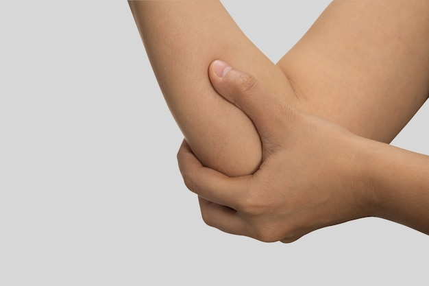 A woman touching her painful elbow, healthcare Premium Photo