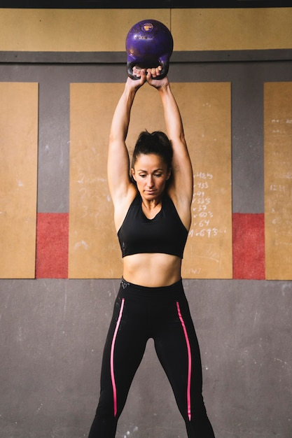 Woman training with kettlebell Free Photo