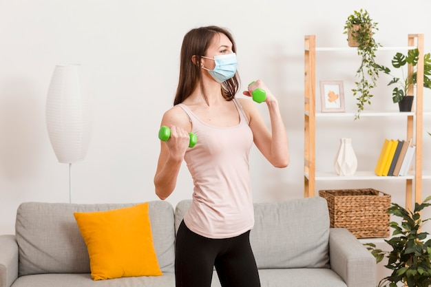 Woman training with mask Free Photo