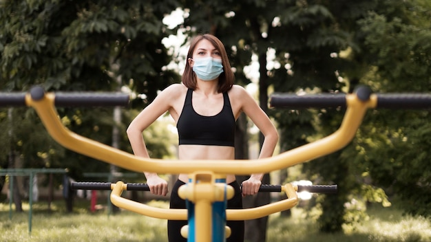 Woman training with a medical mask Free Photo