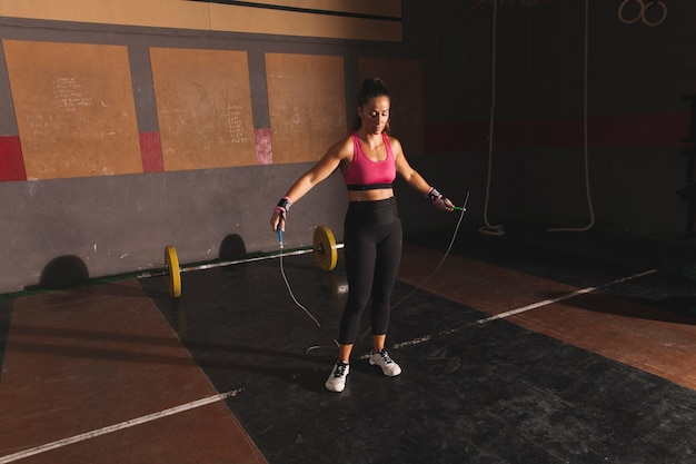 Woman training with skipping rope Free Photo