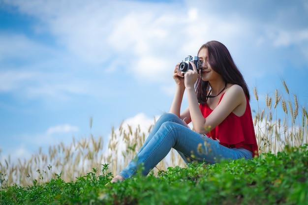 Woman traveler on the barley rice field. Premium Photo