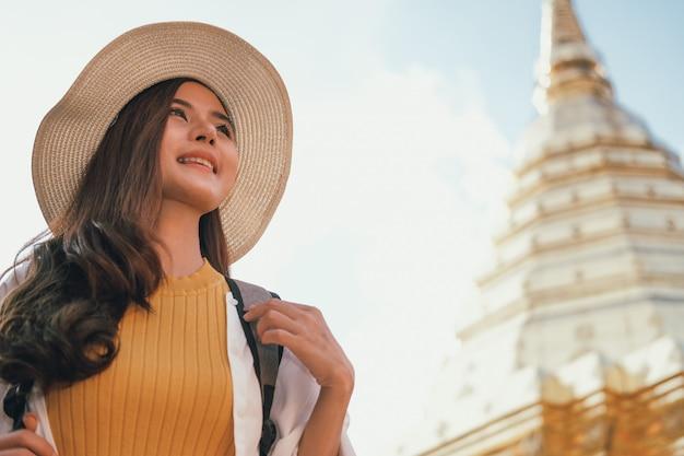 Woman traveler tourist traveling visiting landmark. journey trip travel Premium Photo