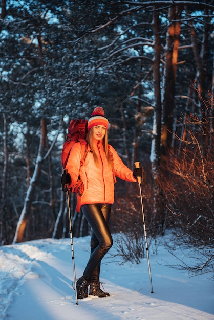 Woman traveler with backpack hiking travel lifestyle adventure  active vacations outdoor. beautiful landscape  forest Premium Photo