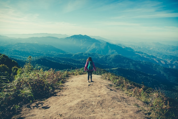 Woman traveler with backpack at mountains view while trekking on doi inthanon Premium Photo