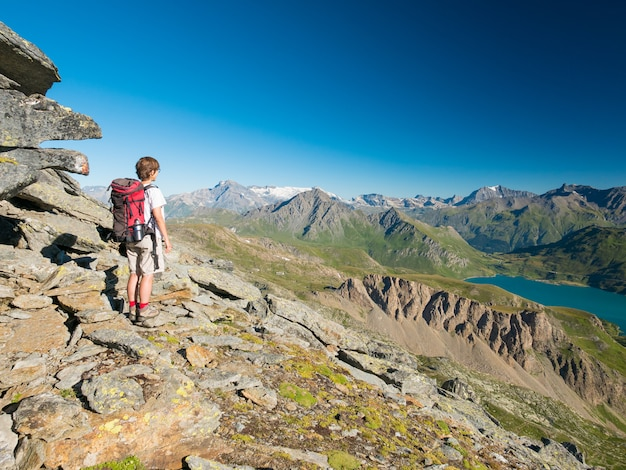 Woman trekking in high altitude rocky mountain landscape. Premium Photo