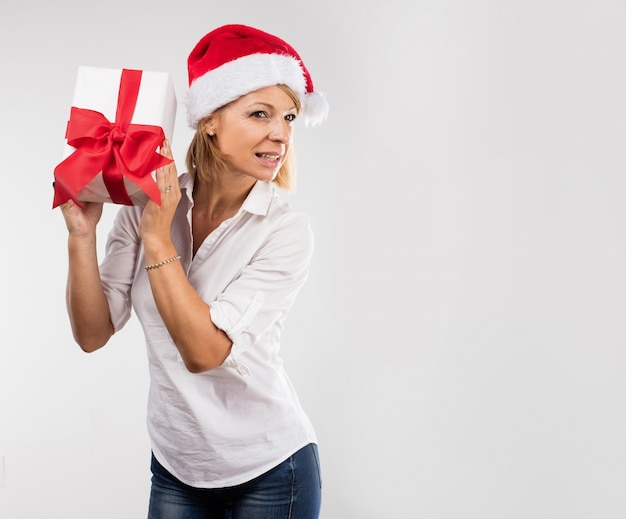Woman trying to guess her gift Free Photo