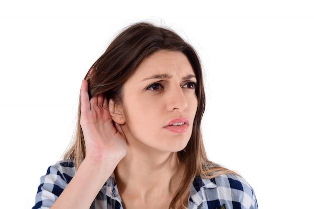 Woman trying to listen something Premium Photo