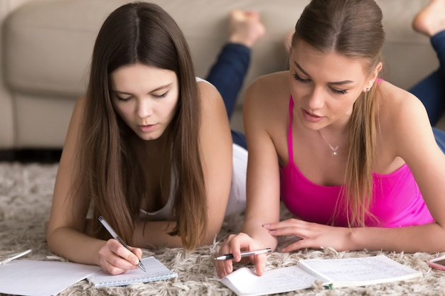 Woman tutor is engaged with teenage girl at home Free Photo