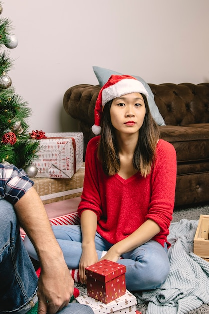 Woman unhappy with present Free Photo