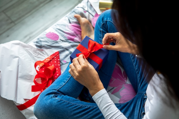 Woman unwrapping her gifts Free Photo