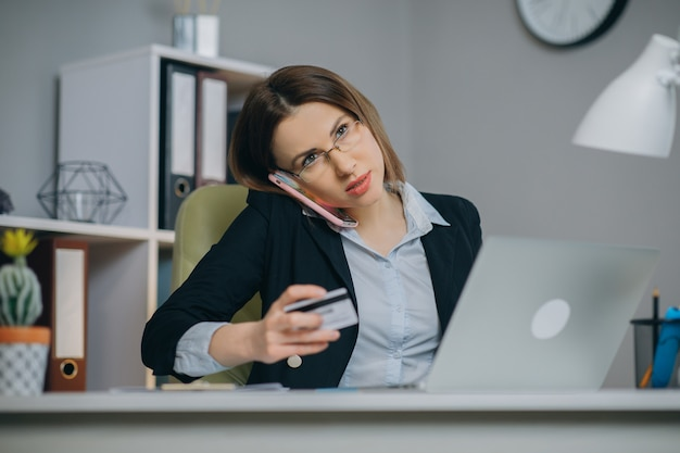 Woman using credit card for shopping online and entering security code using on laptop keyboard. e-commerce and online shopping concept. Premium Photo