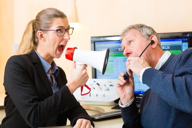 Woman using a loudhailer in hearing test Premium Photo