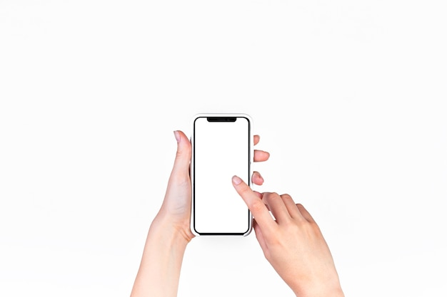 Woman using mobile phone with blank white screen Free Photo