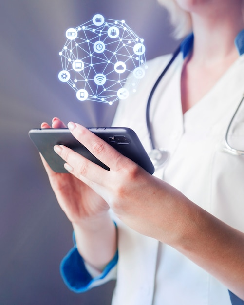 Woman using smartphone with hologram Free Photo