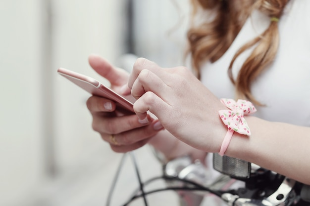 Woman using the smartphone Free Photo