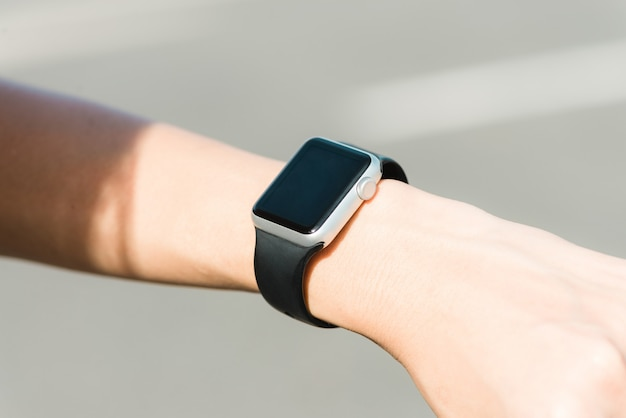 Woman using smartwatch with e-mail notifier. smartwatch hand device notify computer internet message Free Photo