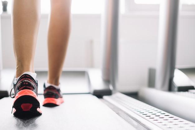 Woman using treadmill Free Photo