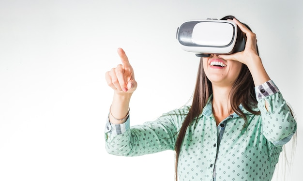 Woman using vr headset being surprised Free Photo
