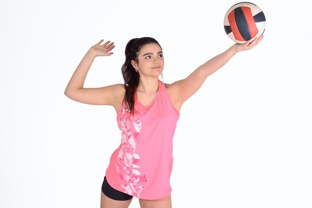 Woman volleyball player hitting the ball. Premium Photo