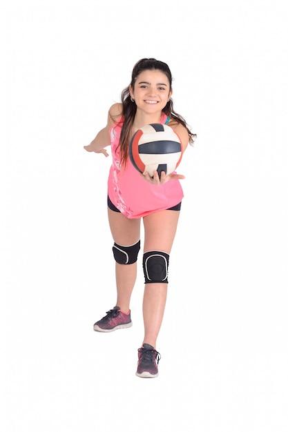 Woman volleyball player hitting the ball. Premium Photo