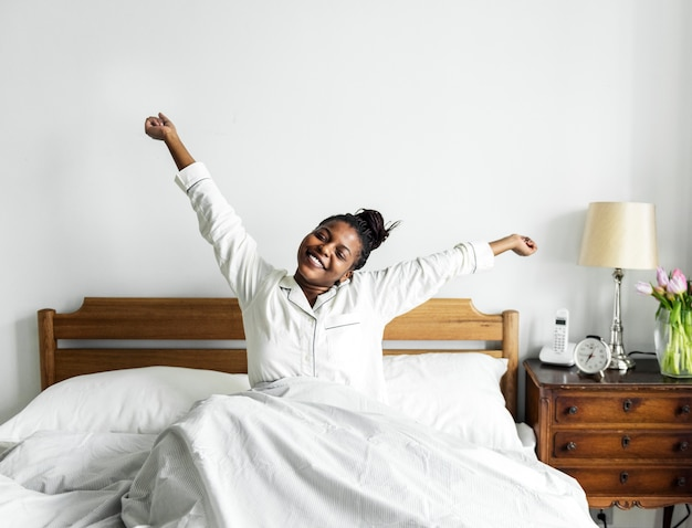 A woman waking up Free Photo