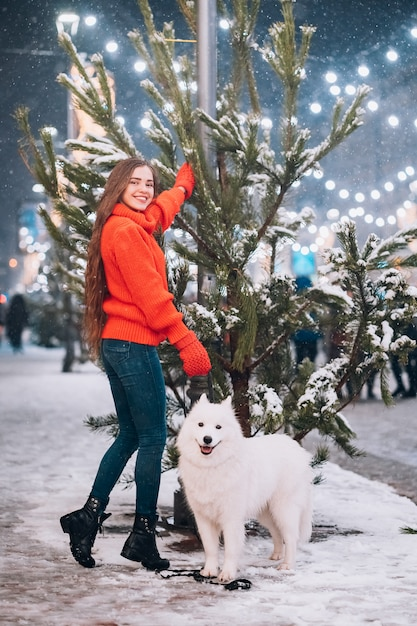 Woman walking down with white dog Free Photo