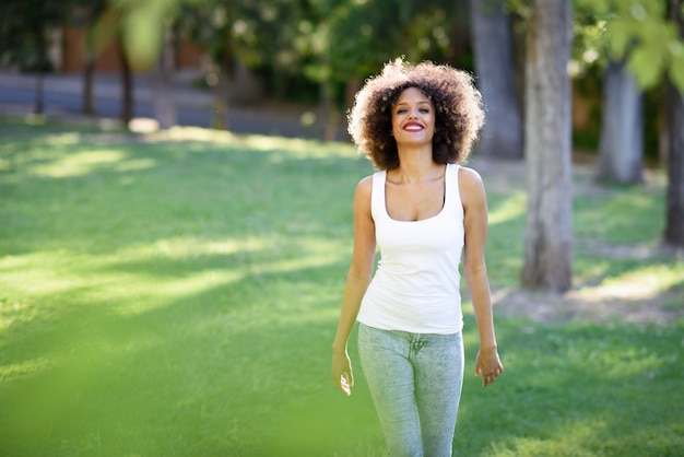 woman walking in a park photo free download