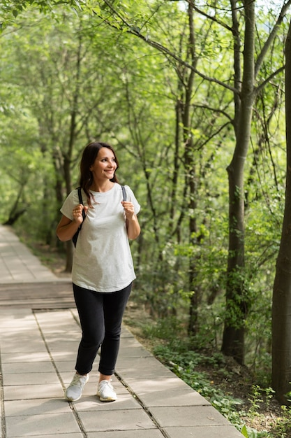 Woman walking in nature Free Photo