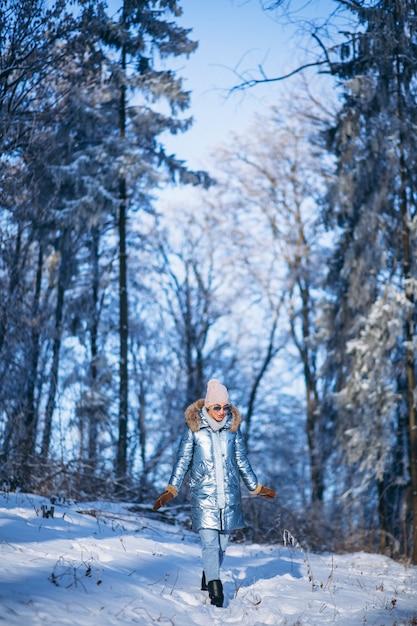 Woman walking in winter park Free Photo