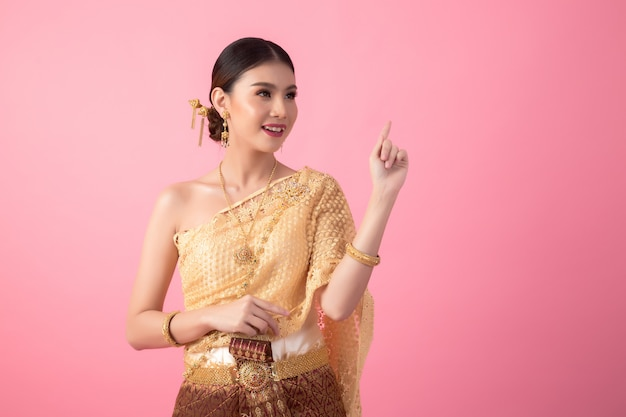 A woman wearing an ancient thai dress Free Photo