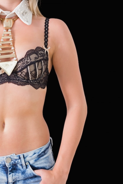Woman wearing bra and golden tie Premium Photo