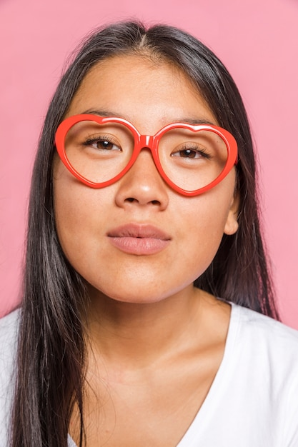 Woman wearing glasses and looking at camera Free Photo