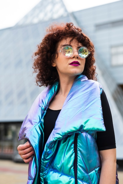 Woman wearing iridescent vest Free Photo