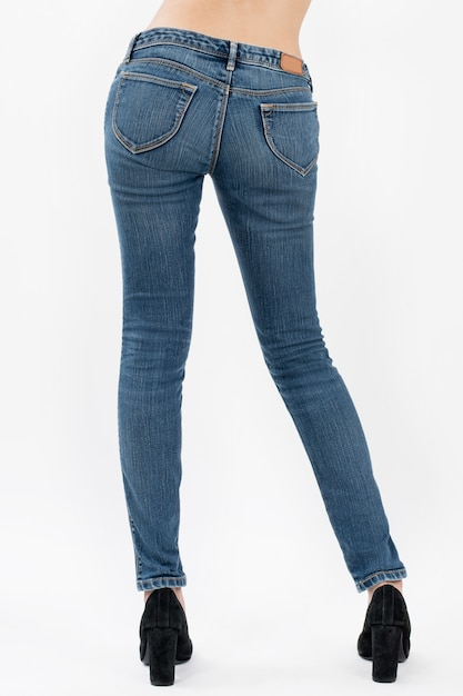 Woman wearing jeans posing back side view half-length isolated on white background Premium Photo