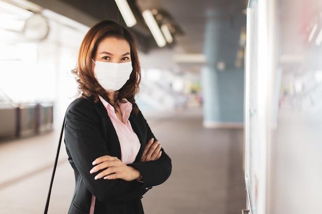 Woman wearing mask reading map. Premium Photo