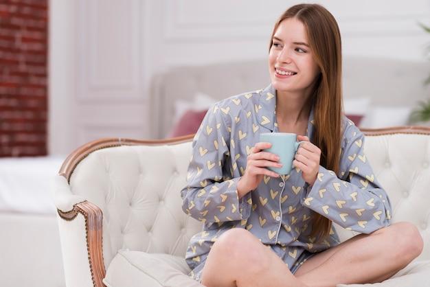 Woman wearing pijama and drinking tea Free Photo