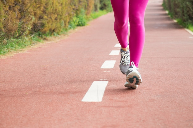 Woman wearing pink tights and grey sneakers Free Photo