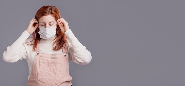 Woman wearing protective mask Free Photo