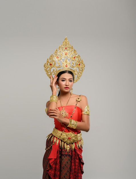 Woman wearing thai clothes and handles on the crown Free Photo