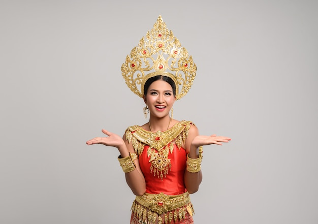 Woman wearing thai dress that made a hand symbol Free Photo