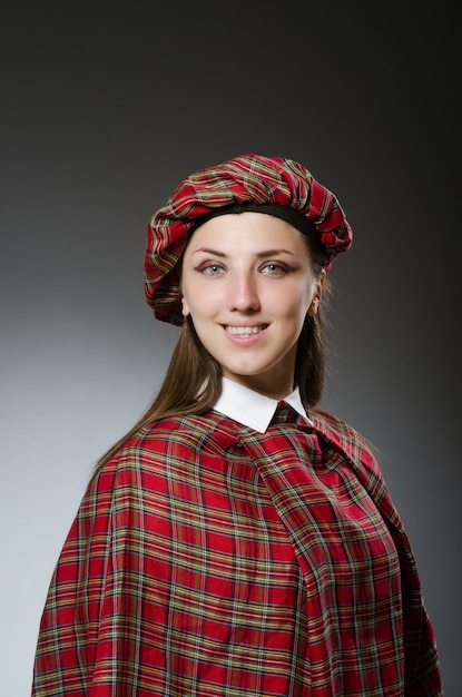Woman wearing traditional scottish clothing Premium Photo