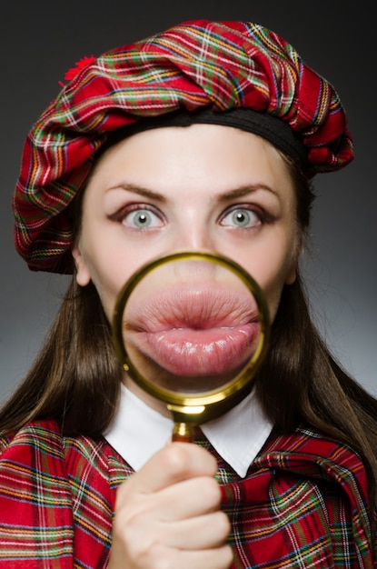 Woman wearing traditional scottish clothing Premium Photo